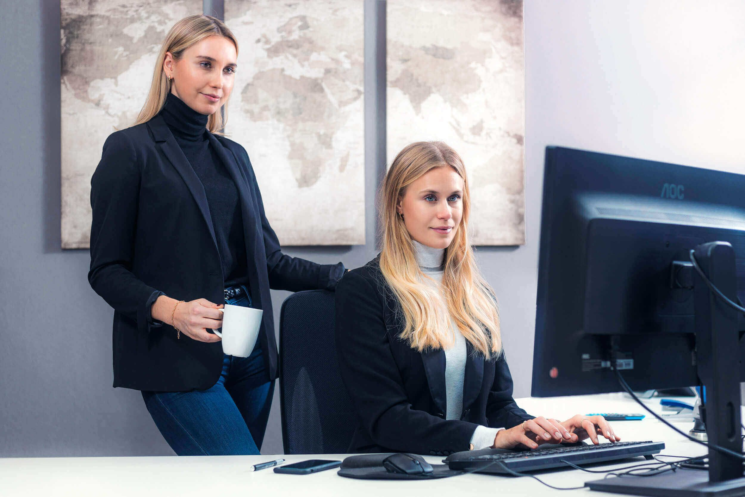 two women looking at monitor